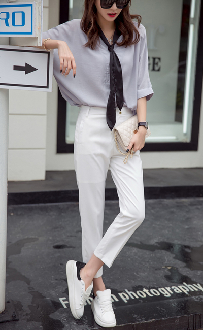 自从高圆圆巴黎时装周穿了侧条纹长裤,这件像校裤一样的潮品就火了